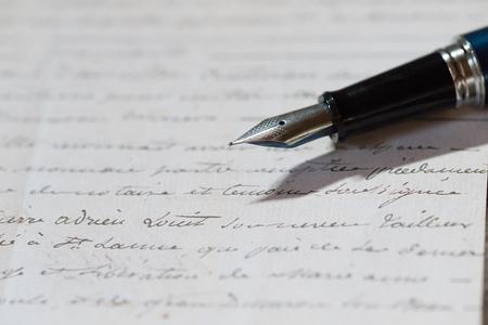 fountain pen and letter Фото со стока