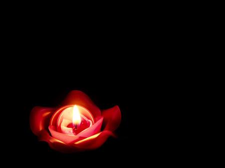 burns night: rose candle Stock Photo