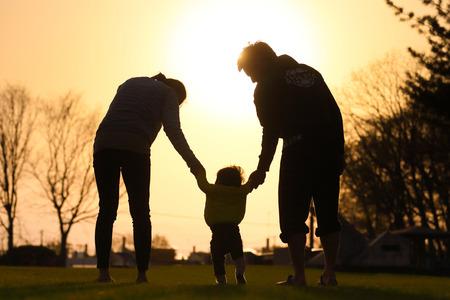 sunset and family Фото со стока