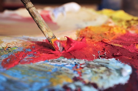 mixing oil paints on a palette photo