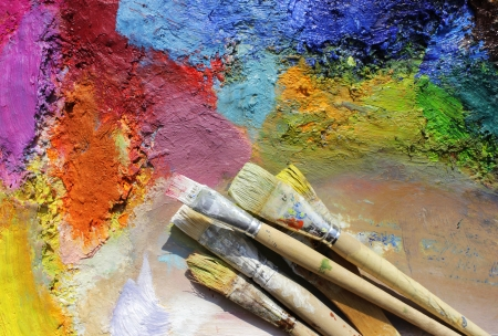 oil paints and paint brushes on a palette photo