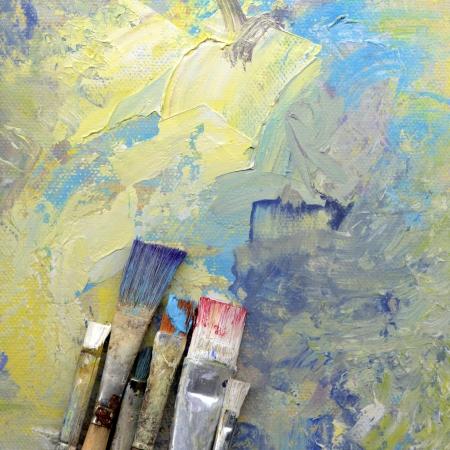 paint brush: paint brushes lying on painted background  Stock Photo
