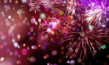 new year eve: stars and lights pattern of bright sparkling colorful fireworks with colorful stars, confetti and circle shapes added Stock Photo