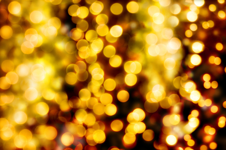 diffuse: defocused bokeh christmas lights background in different golden colors and circle shapes