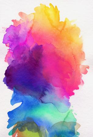 明るい虹色の白い紙の上に水彩絵の具