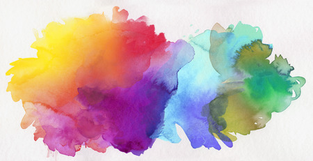 bright rainbow colored watercolor paints on white paper Stock Photo