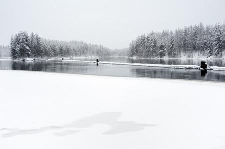River Pielisjoki flowing through winter landscape in Eastern Finland Stock Photo