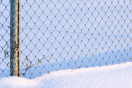 Chain link fence in snow
