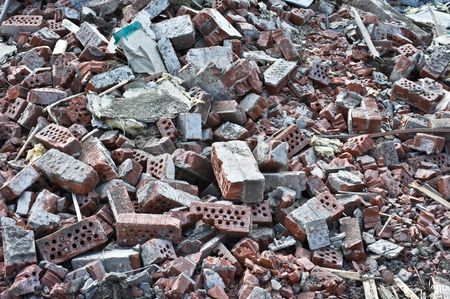 Pile of bricks debris at a building demolition site.