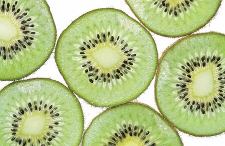 Close-up of kiwi slices isolated on white background.