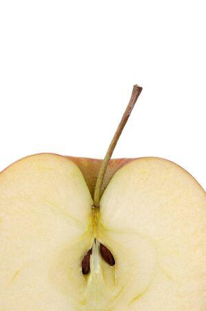 Sliced apple showing seeds and stem