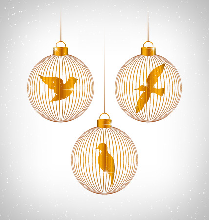 winter grilling: Golden Birds in golden Christmas balls in snowfall on grayscale background
