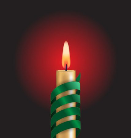 Candle with green spiral tape on dark background photo