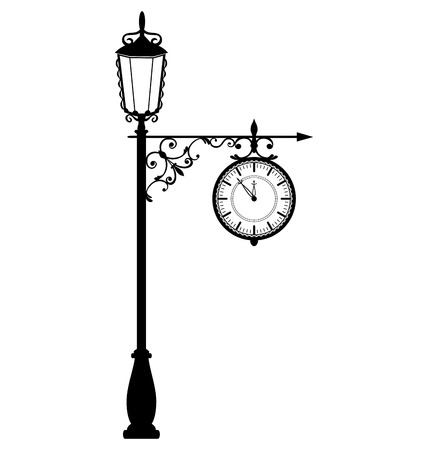 Vintage black lamppost with clock isolated on white background photo