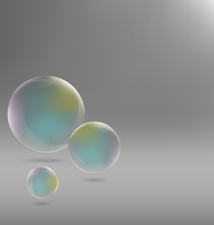 Three transparent soap bubbles with shadows on grayscale background