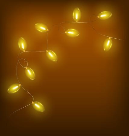 Glowing yellow twisted led Christmas lights garland on brown background photo
