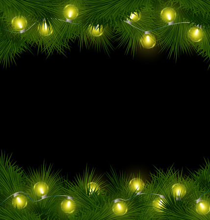 Yellow led Christmas lights on pine branches isolated on black background