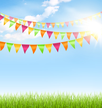 bunting flags: Green grass lawn with bright buntings clouds and sun on blue sky
