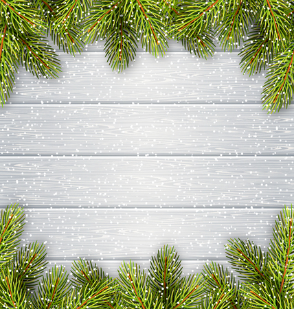 snow: Christmas Tree Pine Branches Like Frame in Snowfall on White Wooden Background