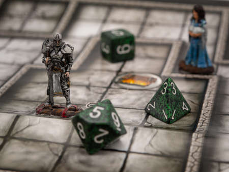 Warrior and mage in a dungeon, role-playing figurines