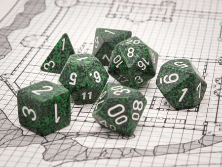 Set of green RPG dice on a gaming map