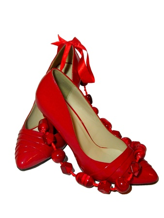 female pair of red shoes and red beads Stock Photo