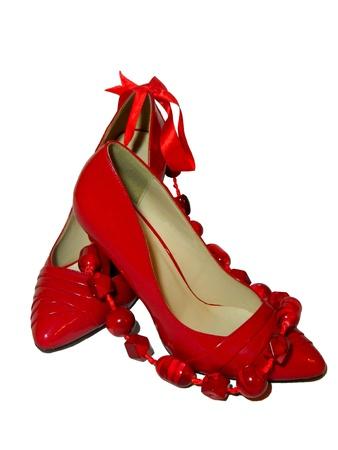 weibliche Paar rote Schuhe und roten Perlen Lizenzfreie Bilder