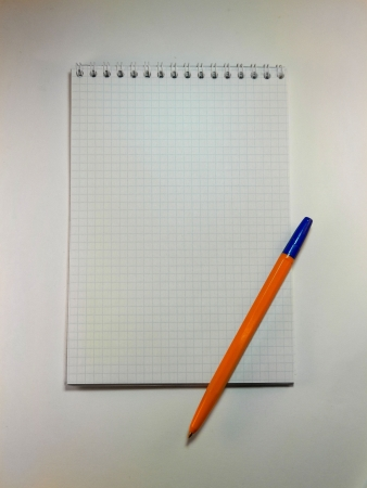 close p: notebook on a white background with shadows                                Stock Photo