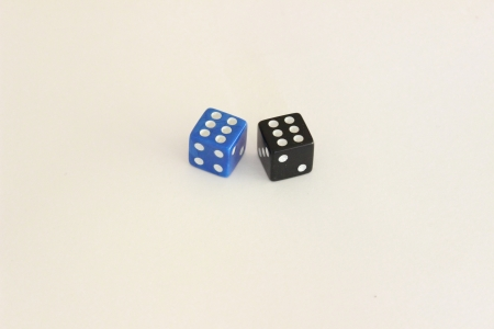 double the chances: A dice on a light background