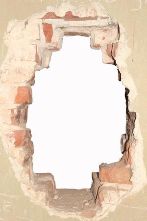 Loch in einer alten Mauer