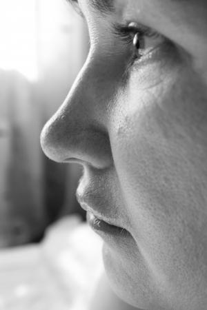 worried woman: grusnoy women face close up Stock Photo