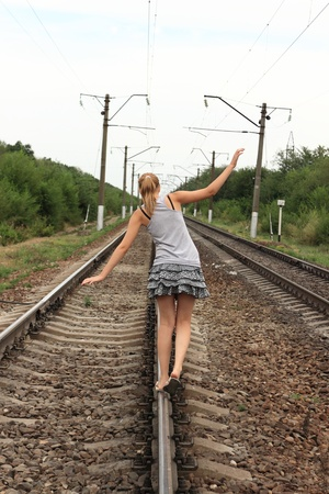 Teen girl goes on rails photo