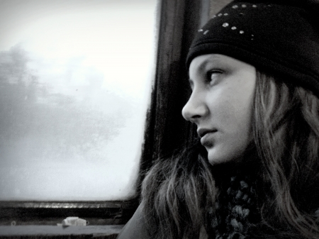 A girl teenager in the doldrums   artistic design  a large grain size, black and white contrast  photo