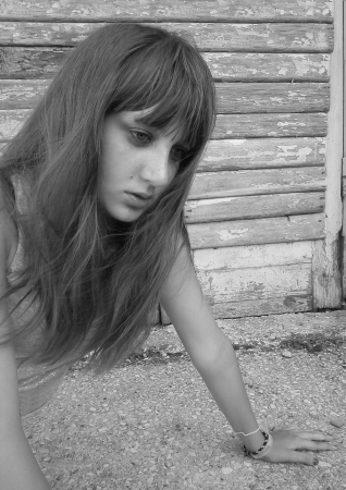 A girl teenager in the doldrums  photo