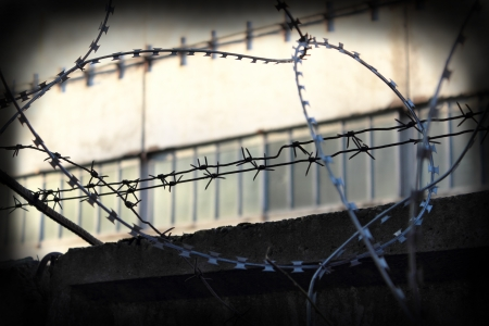 Fence with barbed wire   photo
