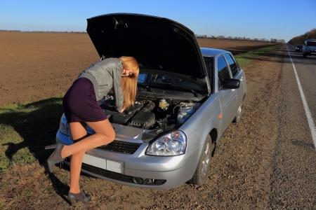 The girl s car broke down Stock Photo - 16412006