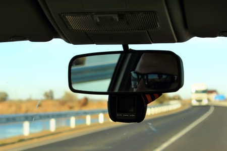 The man in the rear-view mirror