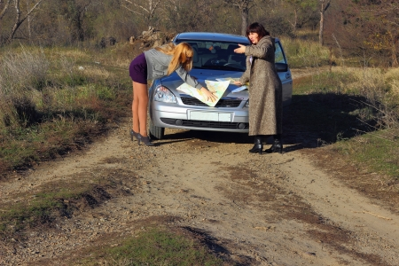Two women looking at the road map Stock Photo - 16412025