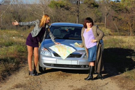 Two women looking at the road map Stock Photo