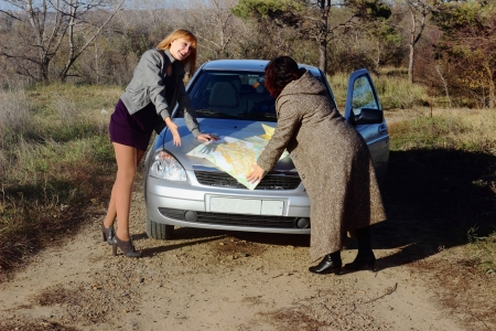 Two women looking at the road map photo