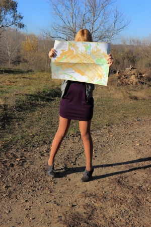 Girl reading a map Stock Photo