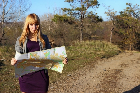 Girl reading a map photo