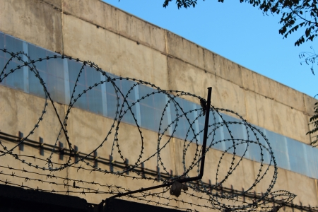 Fence with barbed wire Stock Photo - 17456606