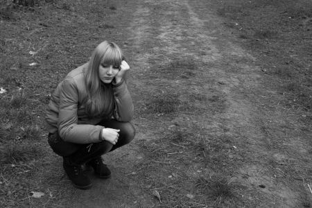 sad girl in the park photo