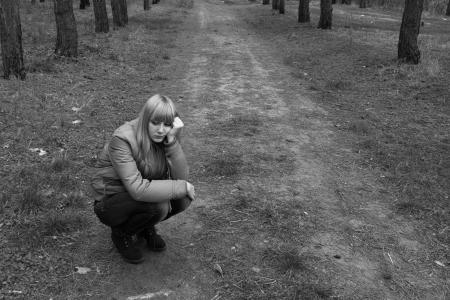sad girl in the park Stock Photo