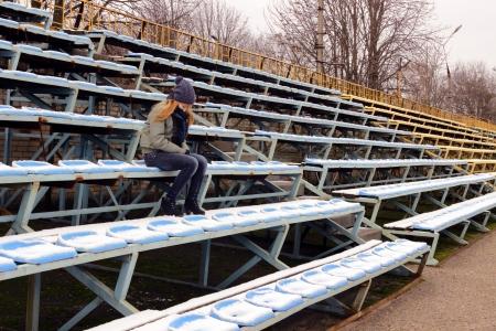 Teen girl at the stadium Stock Photo