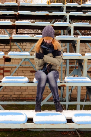 Teen girl at the stadium photo