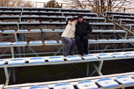 man and woman in the stadium photo