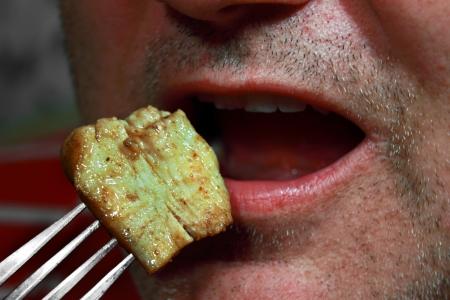 Fleisch auf einer Gabel Lizenzfreie Bilder