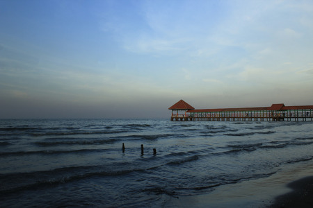 Pier on Purin beach, Tegal Regency, Indonesia with medium waves